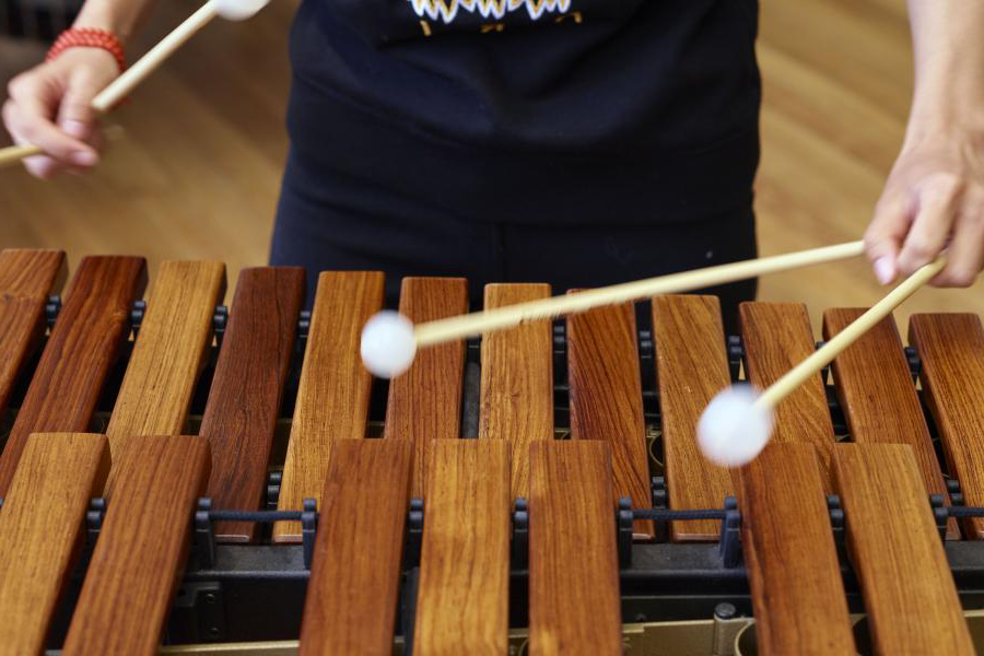 Student playing the xylophone.