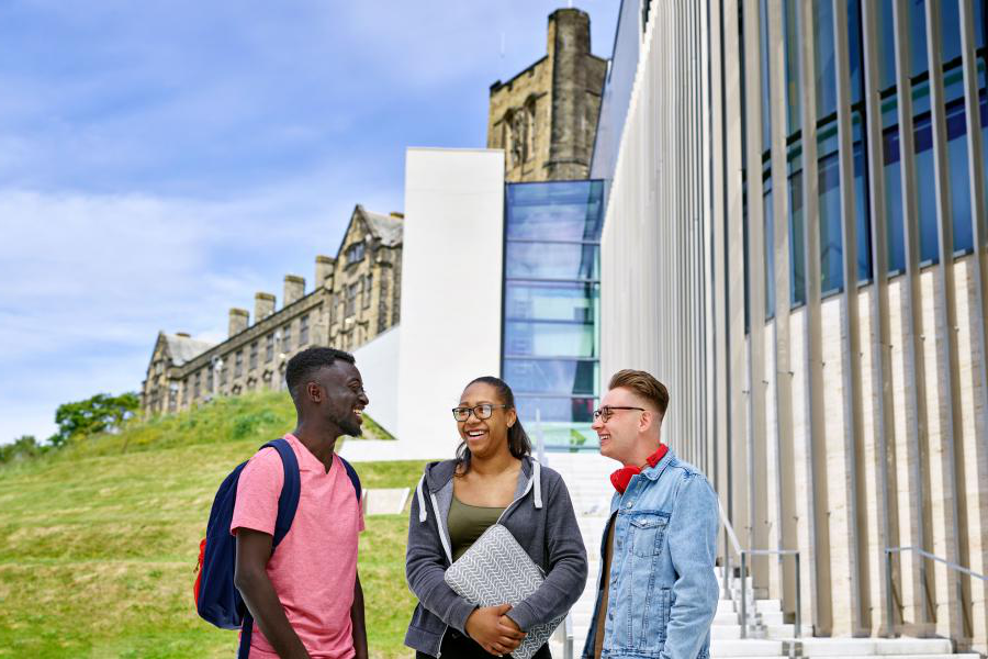Students outside Pontio. with the University's Main Arts Building in the background